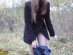 Seducing teenager shows nude charms in the park